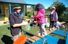 wiradjuri staff member supervising kids in outdoor area