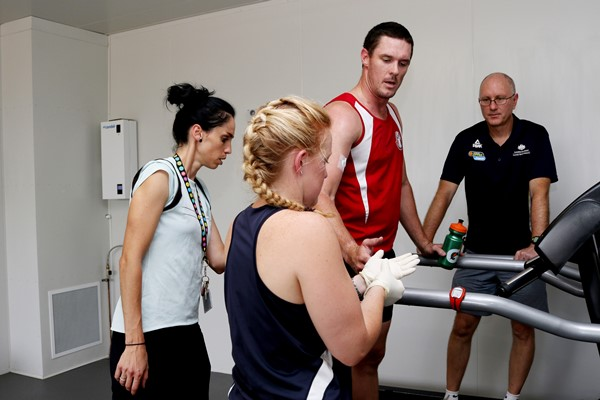 Dr Naroa Etxebarria, PhD candidate Rachel Gale, Ainslie Footballer Damian Bowles and Professor David Pyne in the Environmental Chamber