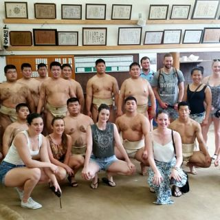 UC students with Japanese sumo wrestlers