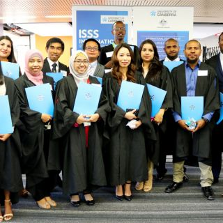 UC Australia Award scholarship students celebrate completing their degrees at a farewell ceremony