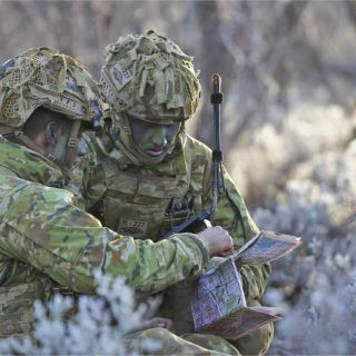 Image of two soldiers in the field