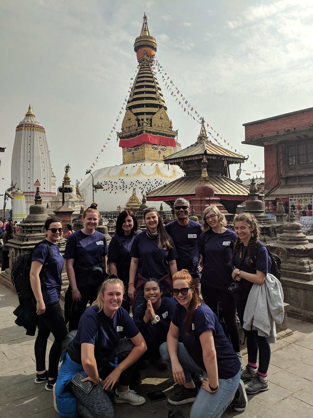 """The UC group at Swayambhunath Stupa in Kathmandu, which boasts panoramic views of Kathmandu. """"We wanted to give the students an understanding of the importance of faith to the Nepalis,"""" Assistant Professor Lawlis said. Photo: Lachhu Thapa/REACH For Nepal"""