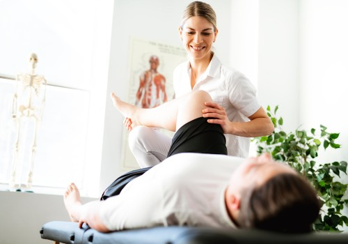 A woman help a man with leg stretches as part of Physiotherapy at UC Health Clinics