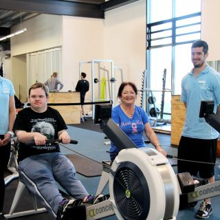 UC exercise physiology students Rebecca Eisenhauer (left) and Brady Foreman (right) training Daniel and Denise Brown