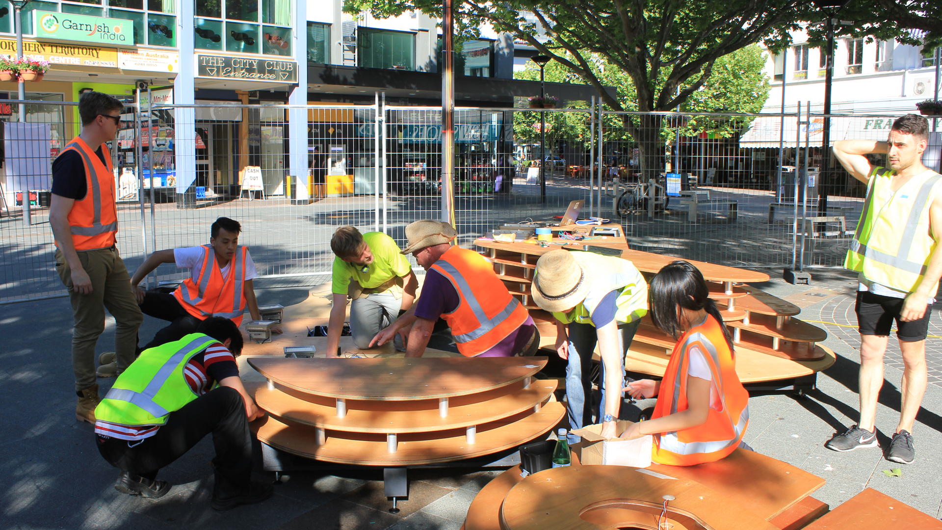 University staff and students install the Pavilion X project at Canberra's Garema Place.