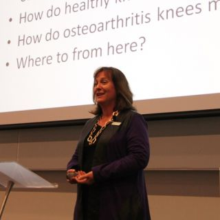 Head of physiotherapy Jennie Scarvell speaks to a lecture room of colleagues and students