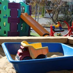toy truck in a sunny sandpit