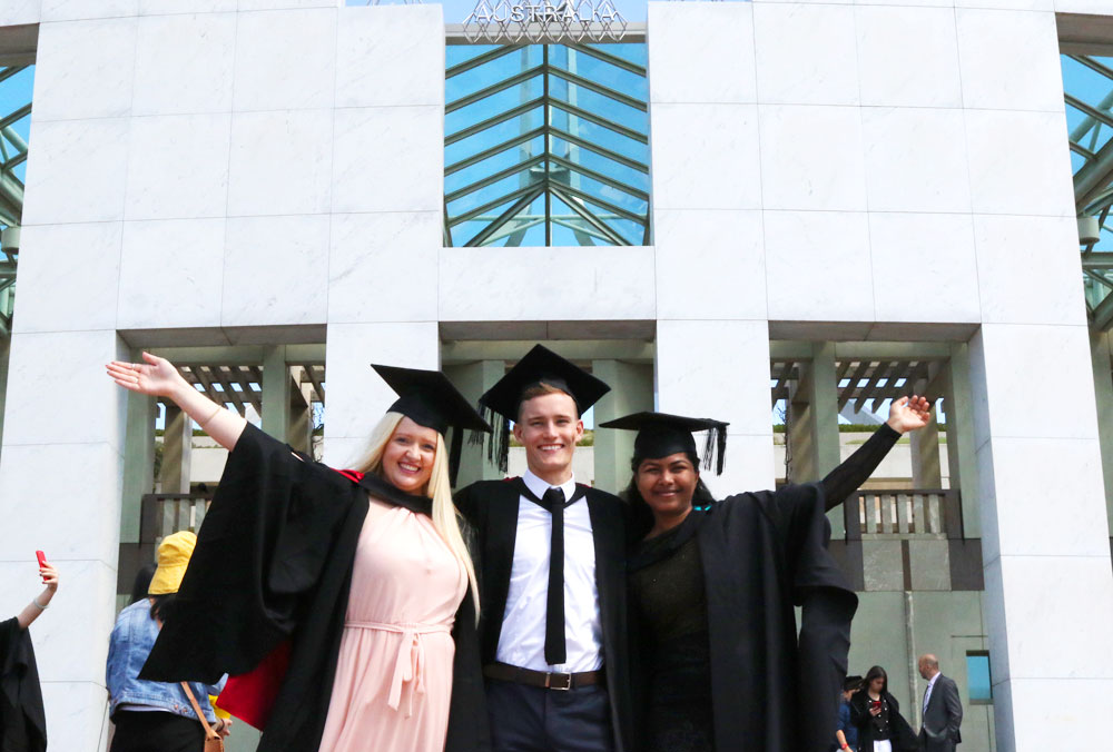 Students celebrate graduating from UC at Parliament House
