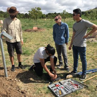 A team of engineers from UC install a soil moisture monitoring system at the Arboretum