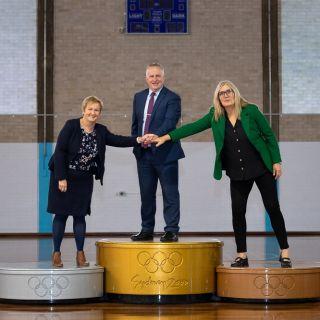 Spokespeople on podium