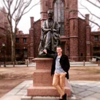 Ben Hamer rests next to the statue of Theodore Dwight Woolsey at Yale University