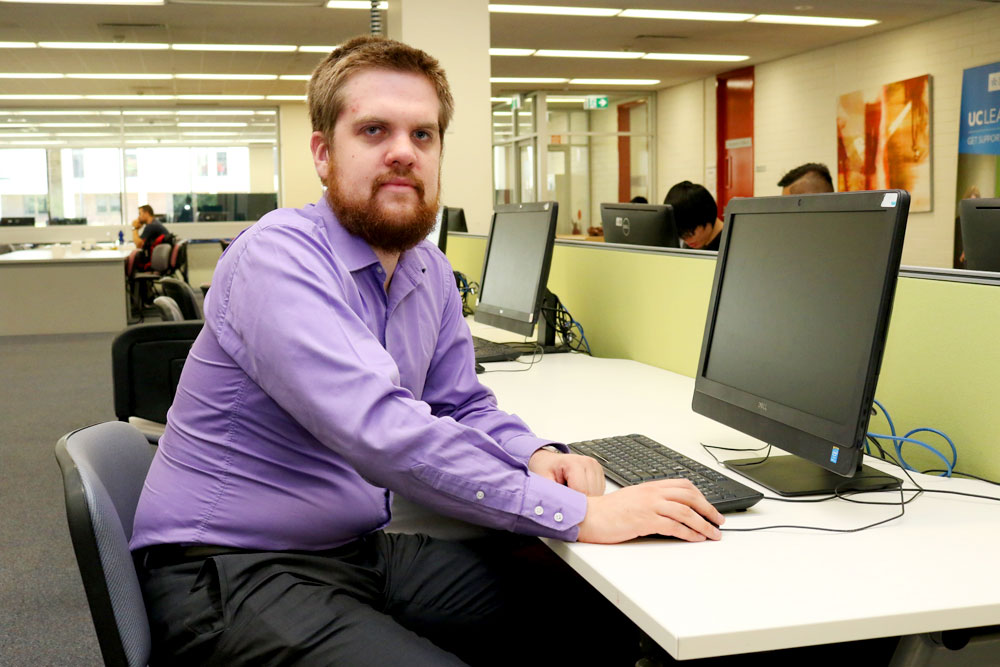 UC student Andrew Duck at the Library