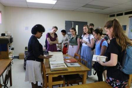 Students are shown historical images of Fiji including colonial buildings