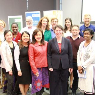 The finalists for the University of Canberra Three Minute Thesis in a group shot, prior to the start of competition