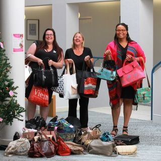 UC staff Naomi Dale, Linda Kujala and Cindy Mitchell carry handbags for the Share the Dignity Collection