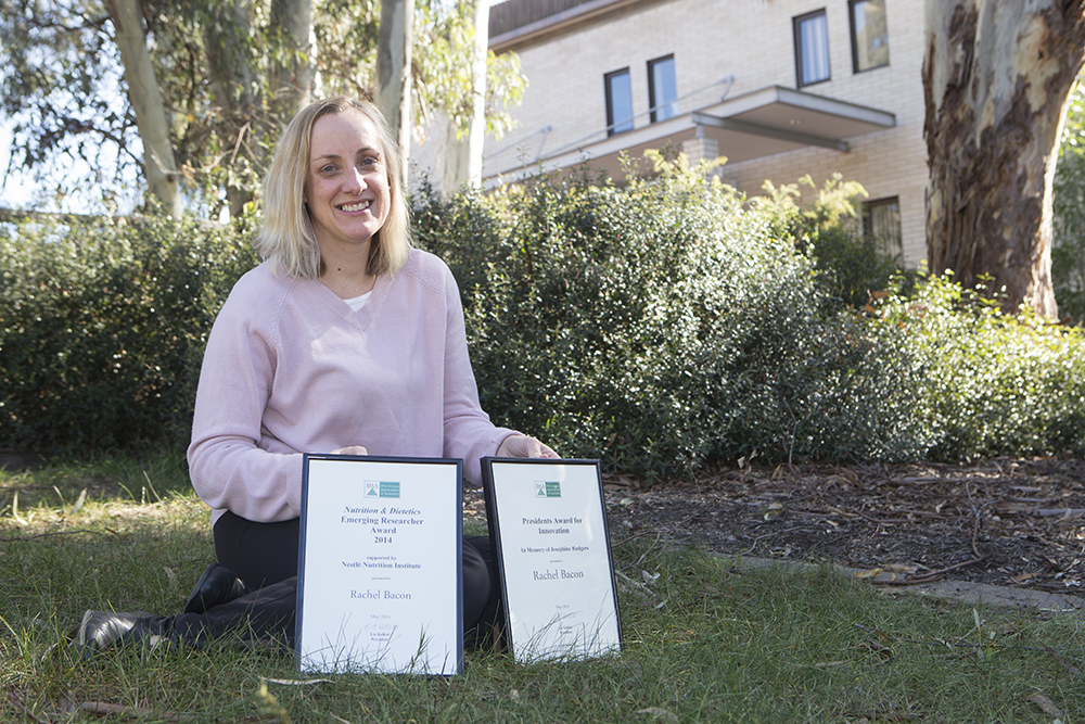 Rachel Bacon pictured with her two Dietitians Association of Australia awards