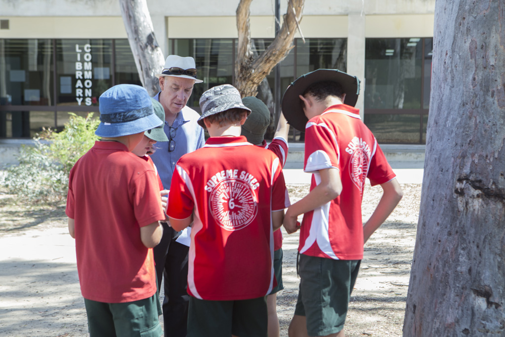 Professor Tom Lowrie with a group of year six students taking part in an orienteering exercise.