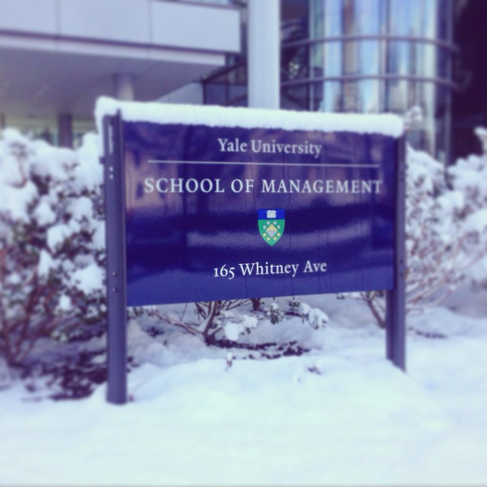 Snow piles up on top of a Yale University sign