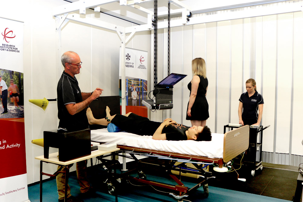 Professor Gordon Waddington and Honours student Ashleigh Marchant work with research volunteers on their proprioception study