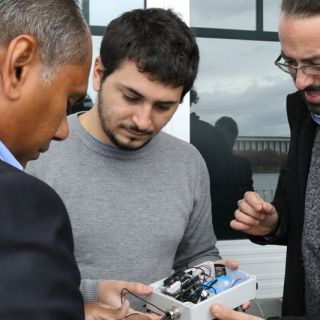 Dr Kumudu Munasinghe and research assistants Adrian Garrido Sanchis and Lorenzo Bertolelli inspect the IoT unit which will be used to eavesdrop on local frogs. Photo: Kim Pham