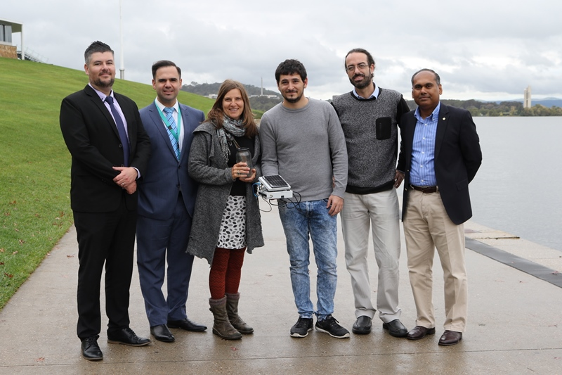 (L to R) Optus Australia's Antonio Garcia and Christian Spiteri, with Frogwatch ACT coordinator Anke Maria Hoefer, University of Canberra research assistants Lorenzo Bertolelli and Adrian Garrido Sanchis and Dr Kumudu Munasinghe. Photo: Kim Pham