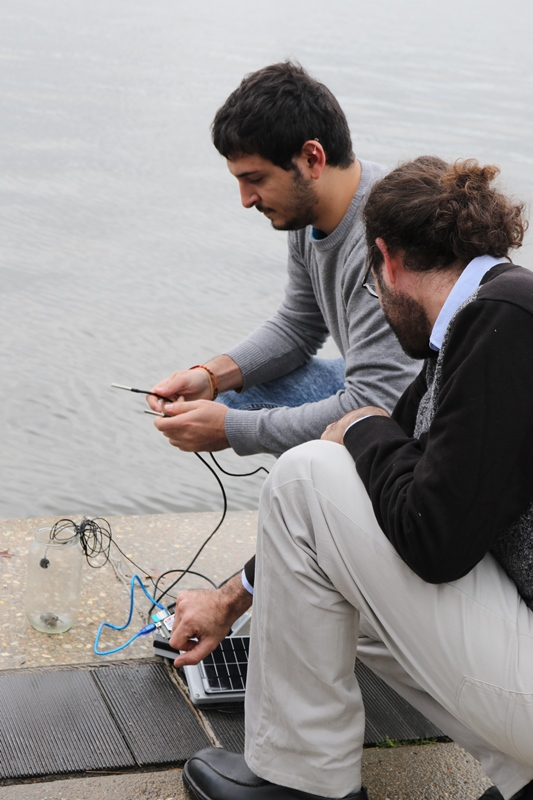 University of Canberra research assistants Lorenzo Bertolelli and Adrian Garrido Sanchis set up the frog call monitoring system with a local frog found by Frogwatch ACT coordinator Anke Maria Hoefer. Photo: Kim Pham